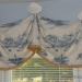 A valance drapes into soft curves and shaped bells