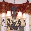 The light fixture consists of durable wrought iron and elegant crystals. Durability and elegance were the feel the client envisioned for the room.