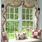 Custom window seat framed with swags and cascades, window seat cushion and decorative pillows