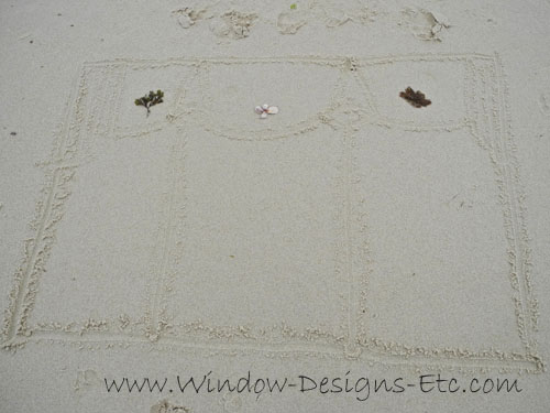 Window treatment drawing in the sand with seaweed and shells. Interior Design inspiration at the beach for a Cape Cod home. See more at www.windowdesignsetc.com by Marie Mouradian
