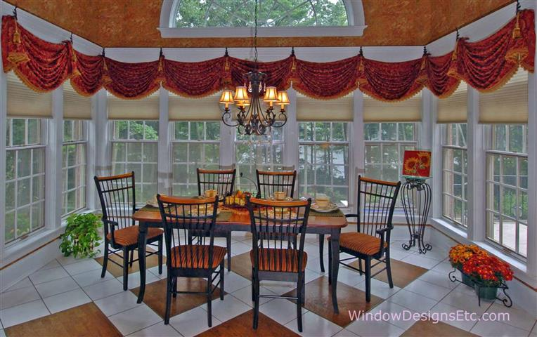 Princeton, MA: The entire family sits down to dinner in this warm and friendly eat-in kitchen. The shades are insulating Hunter Douglas Duettes with the child-safe UltraGlide operating system.