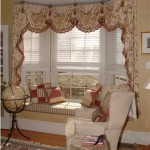 Bay window seat with cushion, pillows, valance and Hunter Douglas Silhouette Window Shadings. Sterling, MA - See more on the blog Window Designs Etc. By Marie Mouradian
