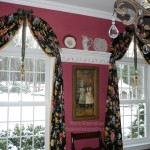 Arched top windows are adorned with a big bow and a glitzy statement ornament for the holidays. More on the blog www.windowdesignsetc.com