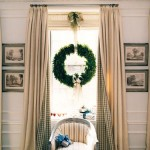 Roman shades and classic draperies are dressed for the holidays with a simple green wreath from House Beautiful. More on the blog www.windowdesignsetc.com