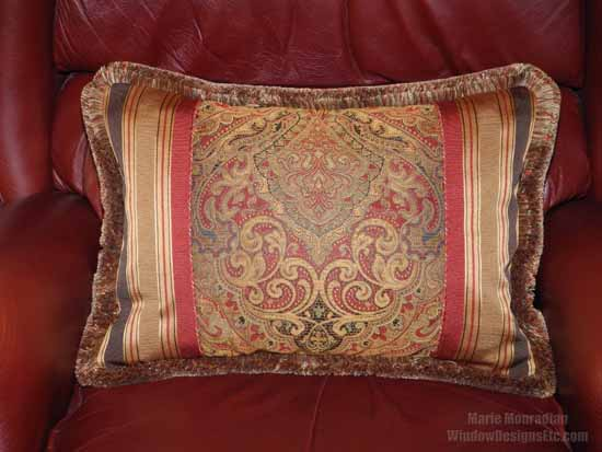 Various fabrics with Marsala make up this custom pillow that enhances the leather chair. Marie Mouradian WindowDesignsEtc.com - Marsala, Pantone 2015 Color of the Year