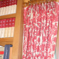 Red and white damask patterned pleated drapes on wooden rod. Designed and Created by Window Designs Etc. By Marie Mouradian