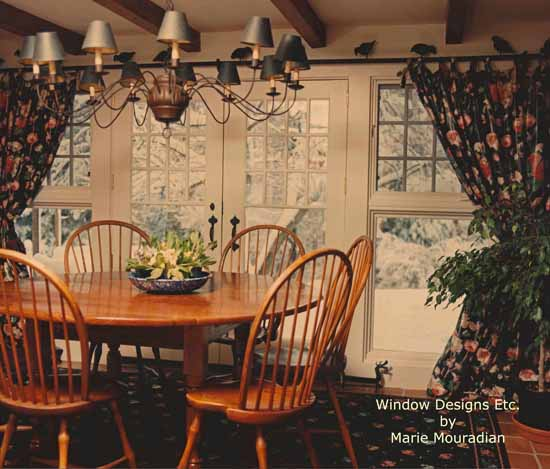 Black floral chintz tied tab panels in a dining room - See more at www.WindowDesignsEtc.com by Marie Mouradian