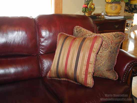 Tones of Marsala Pantone 2015 Color of the year in this leather sofa are brought out with the custom accent pillows. Rich gold is a natural partner to Marsala. - Marie Mouradian WindowDesignsEtc.com - Marsala, Pantone 2015 Color of the Year